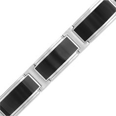 "Wrap his wrist in a strong fashion bracelet that defines style. Crafted in brushed stainless steel, this 12.68mm-wide link bracelet pairs polished ""I""-links with bright white rectangular links decorated with black enamel insets. Polished to a bright shine, this 8.5-inch bracelet secures with a box clasp."