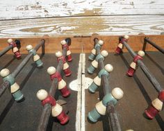 """Vintage Football; Perfect for a game room or a teenage kid's room is this vintage table football, or """"babyfoot,"""" as it is called here in France. It is made of wood and metal, and we love the way the paint has faded softly off the red and blue wooden players. It is from around the 1940s."""