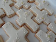 Cross First Communion Cookies - Vanilla sugar cookies covered in MMF with a Fondant dogwood flower and royal icing details.
