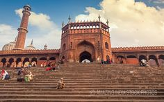 """Jama Masjid Delhi red sandstone entrance gateway. Jama Masjid Delhi previously known as the Masjid-i Jahan-Numa meaning the """"World reflecting Mosque"""" is undoubtedly the largest mosque in India. Located at Old Delhi close to the Red fort the magnificent façade of Jama Masjid stands as the reminiscence of Mughal architecture in India. Click for more stock photos of Jama Masjid and other historical monuments."""