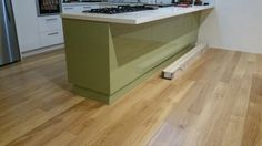 Green kitchen goes  great  with the  floor. empirefloors.com.au
