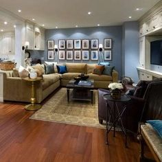 Beautifully Divided - Finished Basement Ideas - 10 Total Makeovers - Bob Vila The hard to see divider on the left would work to separate office/craft/kitchen from TV space.  New ceiling w/pot lights would be much better than the hung acoustical tiles and fluorescents in our basement.