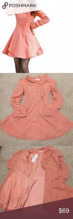 Gorgeous Pink Trench Coat The dang cutest wool blend winter or fall coat you've ever seen, with a beautiful hourglass/baby doll shape. Adorable ruffles and gathered sleeves with big decorative (functioning) buttons. Lined and super cozy cute.  Bust: 37 in Waist: 33 in Jackets & Coats Trench Coats