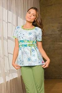 """Dickies Smocked Round Neck Scrub Top in """"Pop Up Posies"""" 82769C-POPU A Junior fit smocked round neckline top features an adjustable front tie, back elastic, side angled pockets and side vents. Center back length: 26 1/2"""".   $22.05 #scrubs #scrubcouture #nurses"""
