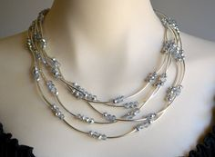 Crystal and silver tube multi strand necklace by starrydreams