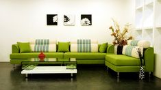 Living Room Ideas With Artwork Portray Attach Painted Over Green Shaped Couch Furnishing with Square Shelving and Black Flooring
