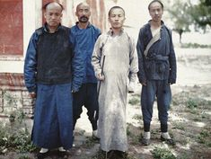 Master and his students near the gate of the imperial college in Beijing, late Qing Dynasty.