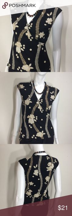 Floral BCBG MAXAZRIA Essentials Top Gently worn. Size Small Floral BCBG MAXAZRIA Essentials Short Sleeve Top. (black top with white / tan flowers).  100% Polyester. Shirt measures approx 16 inches from armpit to armpit and 22 inches in length laying flat. No rips, stains, tears or alterations.  Non smoking home. BCBGMaxAzria Tops
