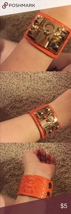 Orange and Gold cuff bracelet Faux orange leather with gold studs and hoop on gold plate. Snap closure, brand new! No scuffs or scratches. Jewelry Bracelets