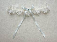 Odille lace garter with silk and swarovski от florriemitton