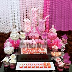 "Pink candy buffet, ""A perfect choice for a bridal shower or brunch."" Chocolate truffles, delicate petits fours and red velvet cupcakes share the table with old-fashioned classics like taffy, jelly beans and marshmallows."