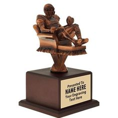 Whose the Couch Potato Out Of Your #FantasyFootball League? This Fantasy Football Trophy Will Suit Them Well! http://www.crownawards.com/StoreFront/TRFFT10.ALL.Trophies.Fantasy_Football_Couch_Potato_Trophy.prod