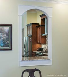 Window pass-thru to the kitchen of The Kenningstone #1166. http://www.dongardner.com/house-plan/1166/the-kenningstone. #Kitchen #HomePlan #HouseDesign