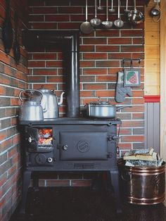 wood burning cook stove | interior design + decorating ideas