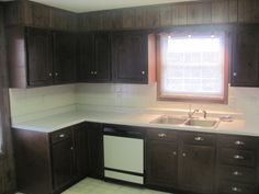 Tons of cabinets in this spacious kitchen.
