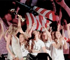 The US Women's National Soccer Team take the stage at the Taylor Swift concert