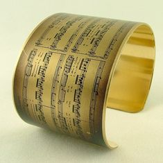 This sheet music bangle. | 25 Unique Gifts Music Lovers Will Want To Keep For Themselves