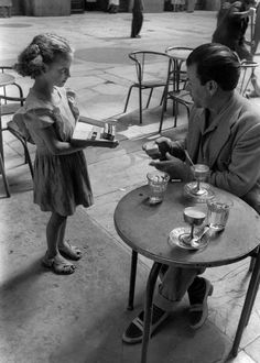 """napolinostalgia: """"A young girl selling cigarettes, which she gets from the Black Market, to people at the cafes, Naples, Italy, 1948 """""""