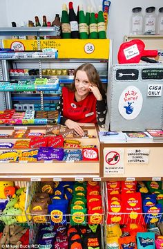 Artist Lucy Sparrow with felt items in The Cornershop. Amazing