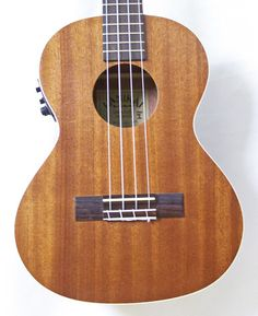 """Lanikai's LU-21TEK is the perfect first stop for acoustic multi-instrumentalist looking to expand their tonal palette or the first time player just beginning their lifelong love of music. All LU series ukuleles include an instruction booklet to guide you into these easy to learn instruments."""