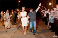 Sparkler leaving with a cute ivory belted dress - Photo by Jason