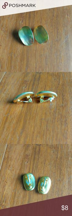80s Gold Clip-on Earrings Good condition. 80s style. The little white squishy thing in the clip-on part is missing from the left earring. Vintage Jewelry Earrings