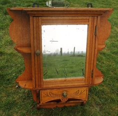 This is a magnificent piece of craftsmanship,beautiful carved wood and a gorgeous small letterbox at the bottom. Description from ebay.com. I searched for this on bing.com/images