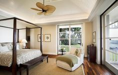 Master Bedroom - Dark Wood Furniture...Walls in Soft Butter and White Trim...Neutral Bedding...Sage Green Accents