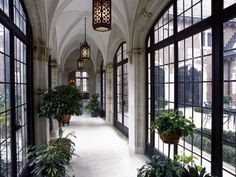 Traditional Hallway with Arched window, Casement, French doors, Wall sconce, Paint, Pendant light, picture window