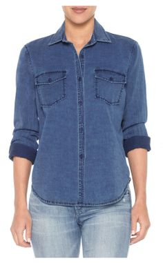 The Brisa Denim Shirt is a long sleeve button-up indigo denim shirt with two chest pockets for a versatile look you can easily dress up or down.