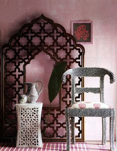 theiainteriordesign:  Madeline Weinrib Indian Raspberry Classic Cotton Carpet and Pink Stella Blockprint upholstered chair in Elle Decor November 2008.