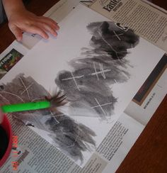Write or draw something in white crayon on white paper then paint over with watered-down black paint to make the image appear.