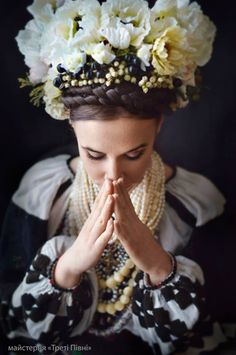 Absolutely stunning modern outfit based on traditional Ukrainian costumes with a huge headdress made out of white flowers. Would make super cool wedding dress for a Ukrainian woman's wedding.