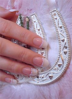 Accentuate a French manicure with cream pearls. http://www.sparkly-nails.co.uk/15mm-Round-Pearls_c_645.html