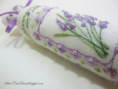 Lavender bar / Lavender Needleroll -- really lovely!! check the close-up so you can see how nicely the specialty stitches add dimension to the lavender, the beading, and the way she uses daisy stitches to create a bow at the corners of the frame around the lavender sprig.