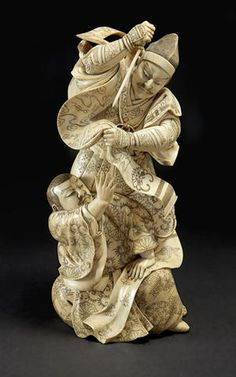 An ivory model of Soga Goro slaying Kudo Suketsune By Nobuyoshi, Meiji period, late 19th century
