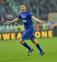 Juventus defender Stephan Lichtsteiner celebrates after scoring during a Serie A soccer match between Juventus and  Parma at the Juventus stadium, in Turin, Italy, Sunday, Nov. 9, 2014. (AP Photo/ Mas
