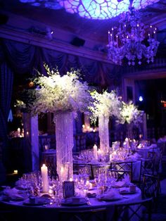 Check out this lighting at a purple floral luxe wedding reception - a bit dark but still like how they really went for it