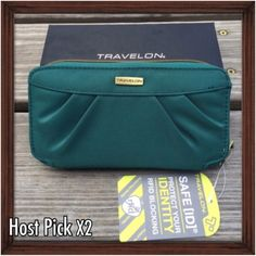 HP: Travelon RFID Blocking Clutch Wallet This Travelon clutch wallet is perfect to use as a small purse. Usable as a clutch or carried in your purse as a wallet the double zip carrier keeps your identity from unauthorized access with its RFID blocking protection. Features a removable wrist strap. NWT and in box.  Best in Boutiques Host Pick 2X. Travelon Bags Clutches & Wristlets