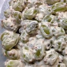Green Grape Salad, Prep Time: 15 Minutes, Serves: 8 Servings, Directions: Wash and dry grapes. In a large bowl, mix together the cream cheese, sour cream, sugar and vanilla. Add grapes and mix until evenly incorporated. Sprinkle with brown sugar and pecans, mix again and refrigerate until serving.