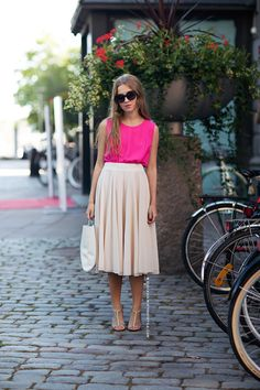 neon sleeveless top and neutral skirt