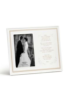 """Format: Frame  Name: Wedding Prayer Ceramic Frame  Packaging Info: Gift Box  Materials: porcelain  Measurements: 13""""w x 9.5""""h  Seasonality: Everyday  Sentiment: Lord, Help us to remember when we first me and the strong love that grew between us. Help us to always protect our love so that nothing can divide us. We ask for kind words and loving hearts, always ready to ask forgiveness as well as to forgive. Dear Lord, with faith and hope, we put our marriage into your hands. Amen. Wedding…"""