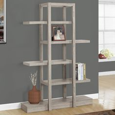 Features:  -Modern Open concept design.  -Sturdy construction in a chic reclaimed-look finish.  -5 Spacious zig-zag style storage shelves for displaying your favorite items.  Product Type: -Accent she