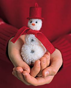 just inspiration for designing own pom-pom snowman using homemade pom-poms in 3 sizes, rolled fabric hat (fleece or wool)  and scarf