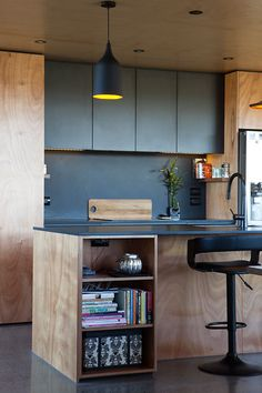 Box Living | KITCHEN | Gaboon ply with Black melamine cupboards and a Hoop Pine ceiling.