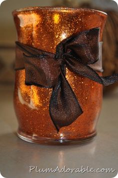 Beautiful DIY Vase using Mod Podge and glitter of your choice. The vase was purchased at the dollar store!