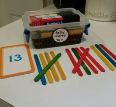 Math Center tally marks. Popsicle sticks and a set of numbers.