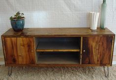 Rustic, Reclaimed, Mid-Century inspired entertainment center TV stand- made to order. $1,700.00, via Etsy.