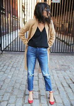distressed cropped jeans with a long camel coat on manrepeller