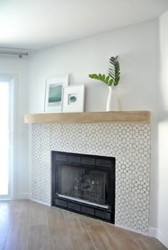 corner fireplace redo with tile and simple mantle modern